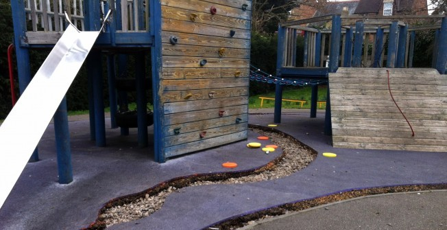 Wetpour Surface Repairs in Abbots Morton