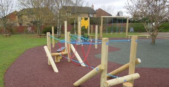 Maintaining Rubber Playgrounds in Y Ff